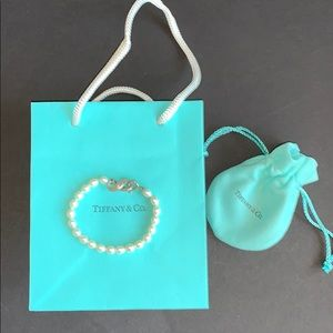 Tiffany & Co. pearl bracelet with infinity charm